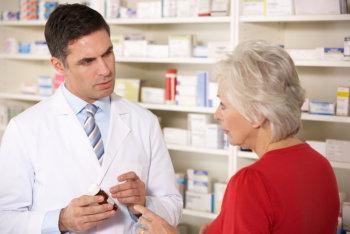 pharmacist talking to an elderly woman